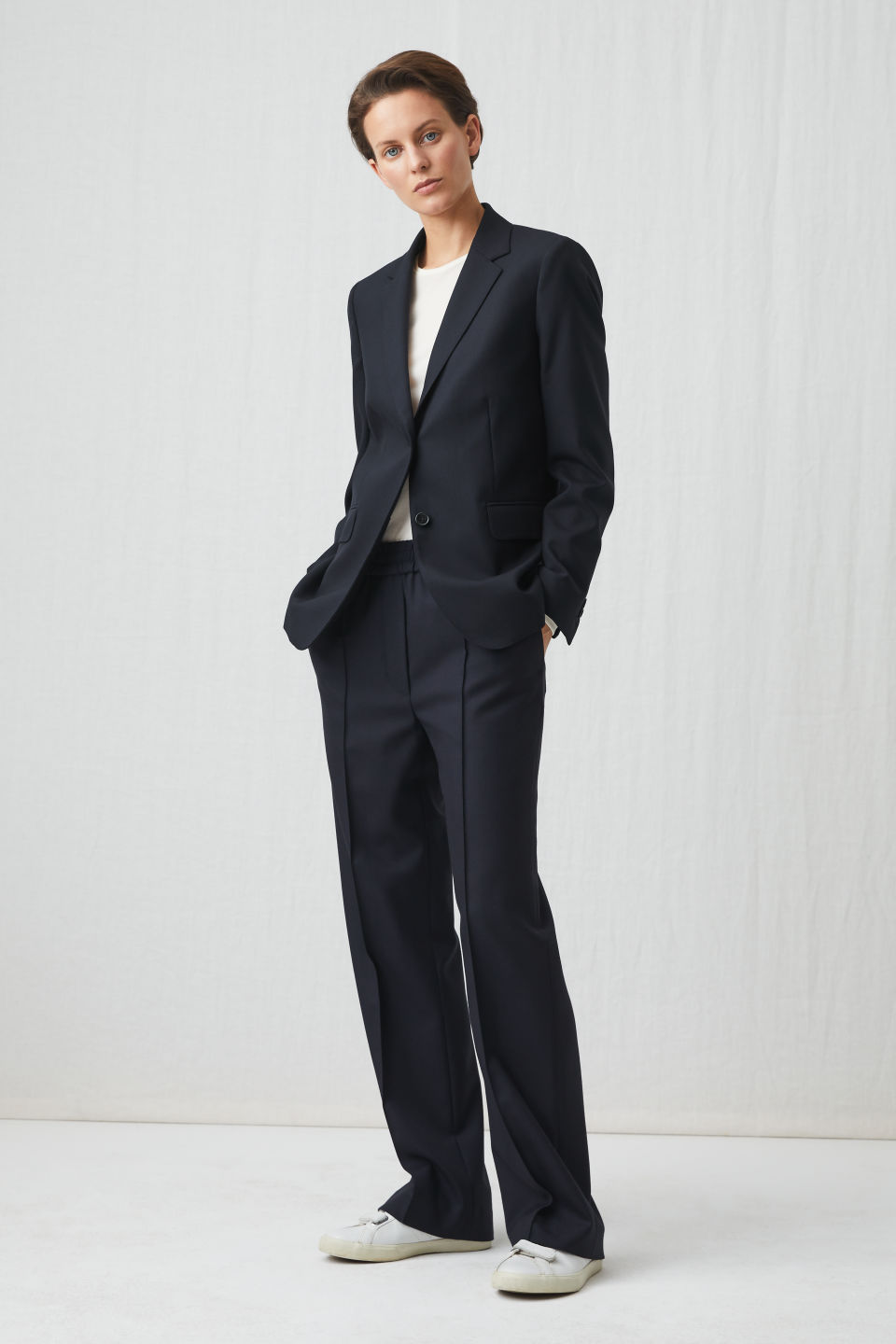 Model front image of Arket elastic waist wool trousers in blue