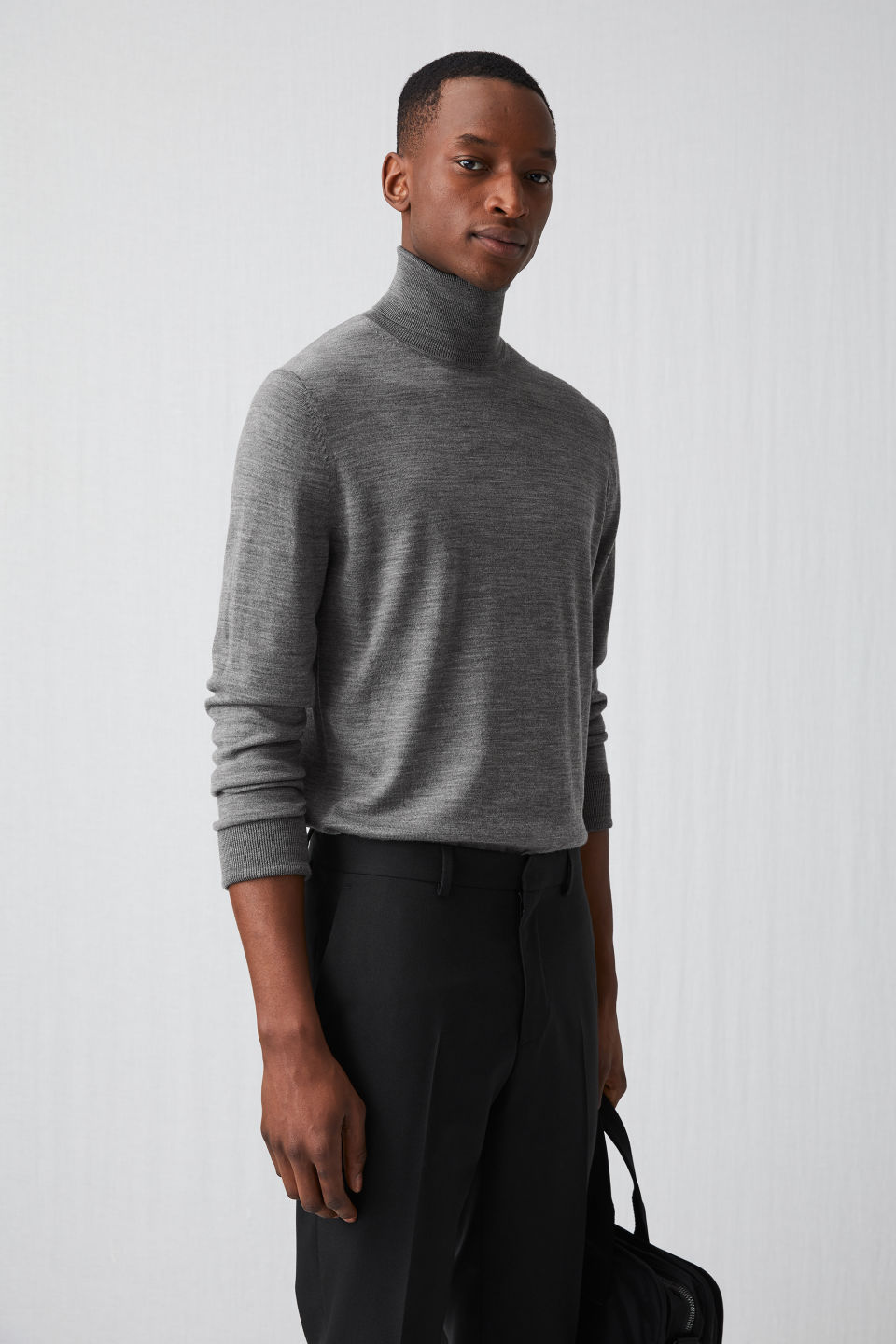 Model side image of Arket merino roll-neck jumper in grey