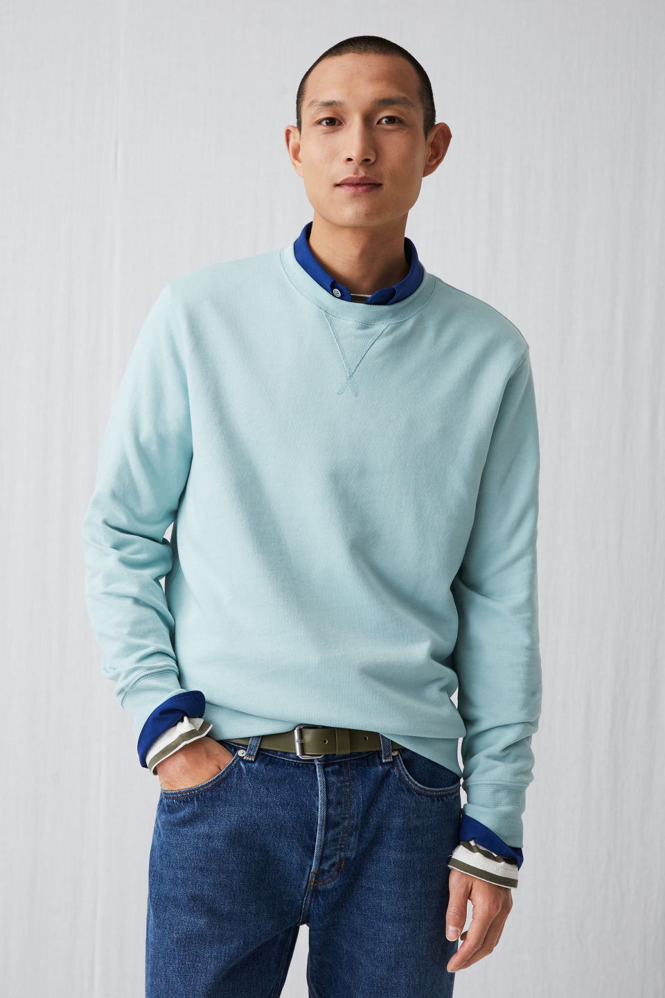 Model side image of Arket french terry sweatshirt in turquoise
