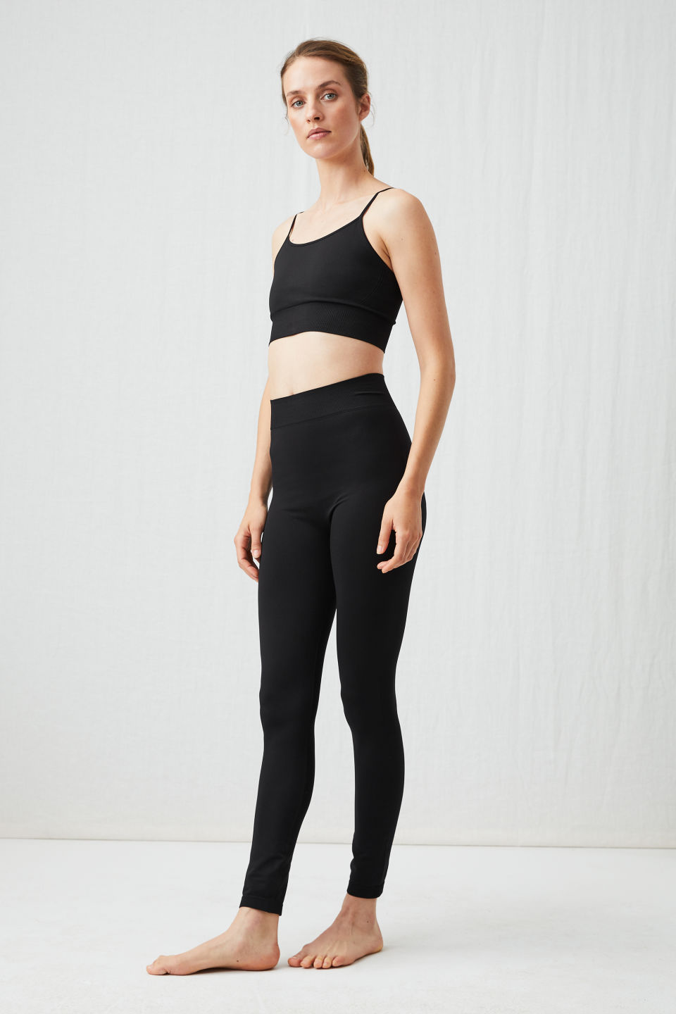 Model front image of Arket seamless yoga tights in black