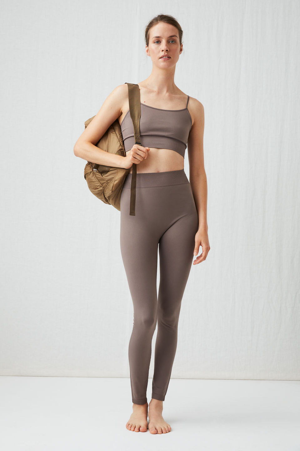 Model front image of Arket seamless yoga tights in beige