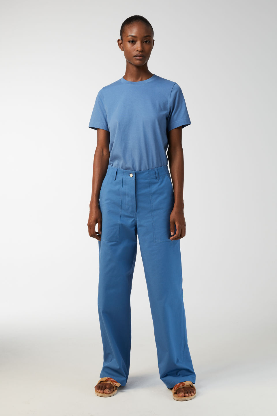 Model side image of Arket cotton twill workwear trousers in blue