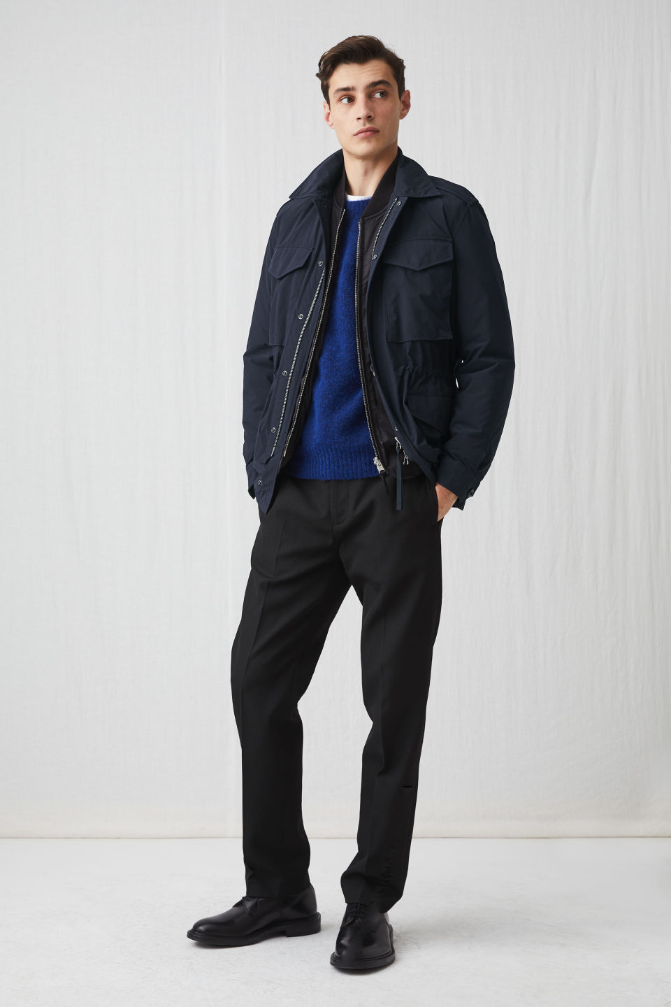 Model side image of Arket lightweight field jacket in blue