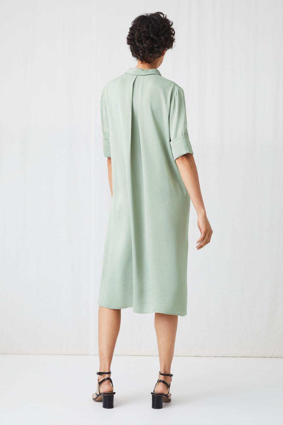 Model side image of Arket a-line satin dress in green