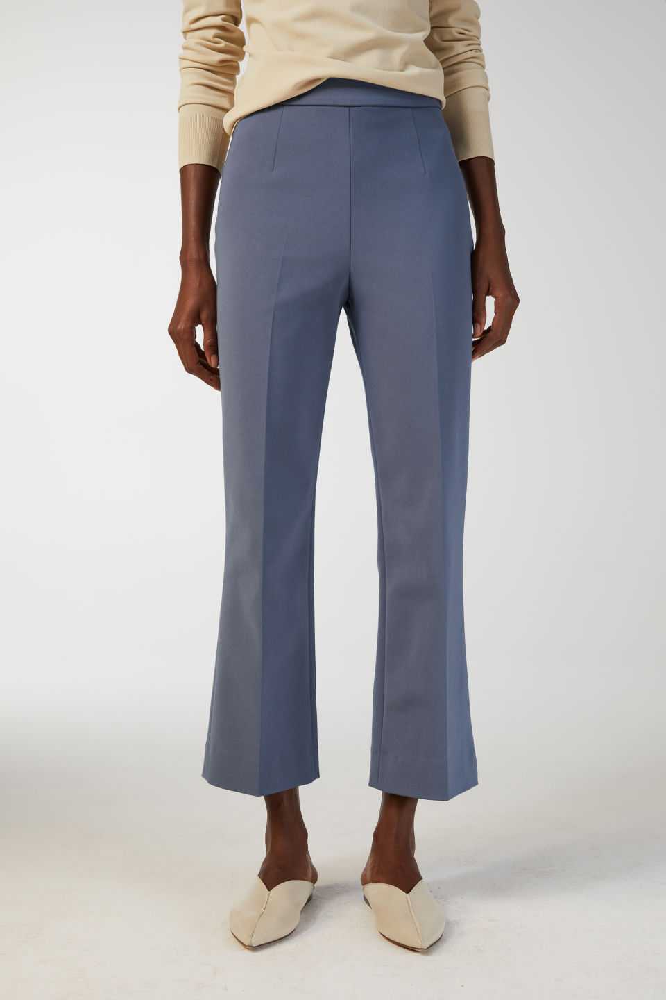 Model side image of Arket cropped cotton trousers in blue