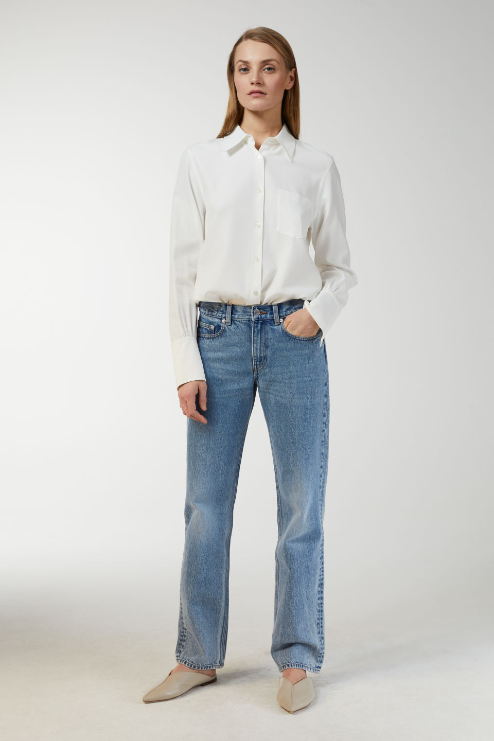 Model side image of Arket fluid twill blouse in white