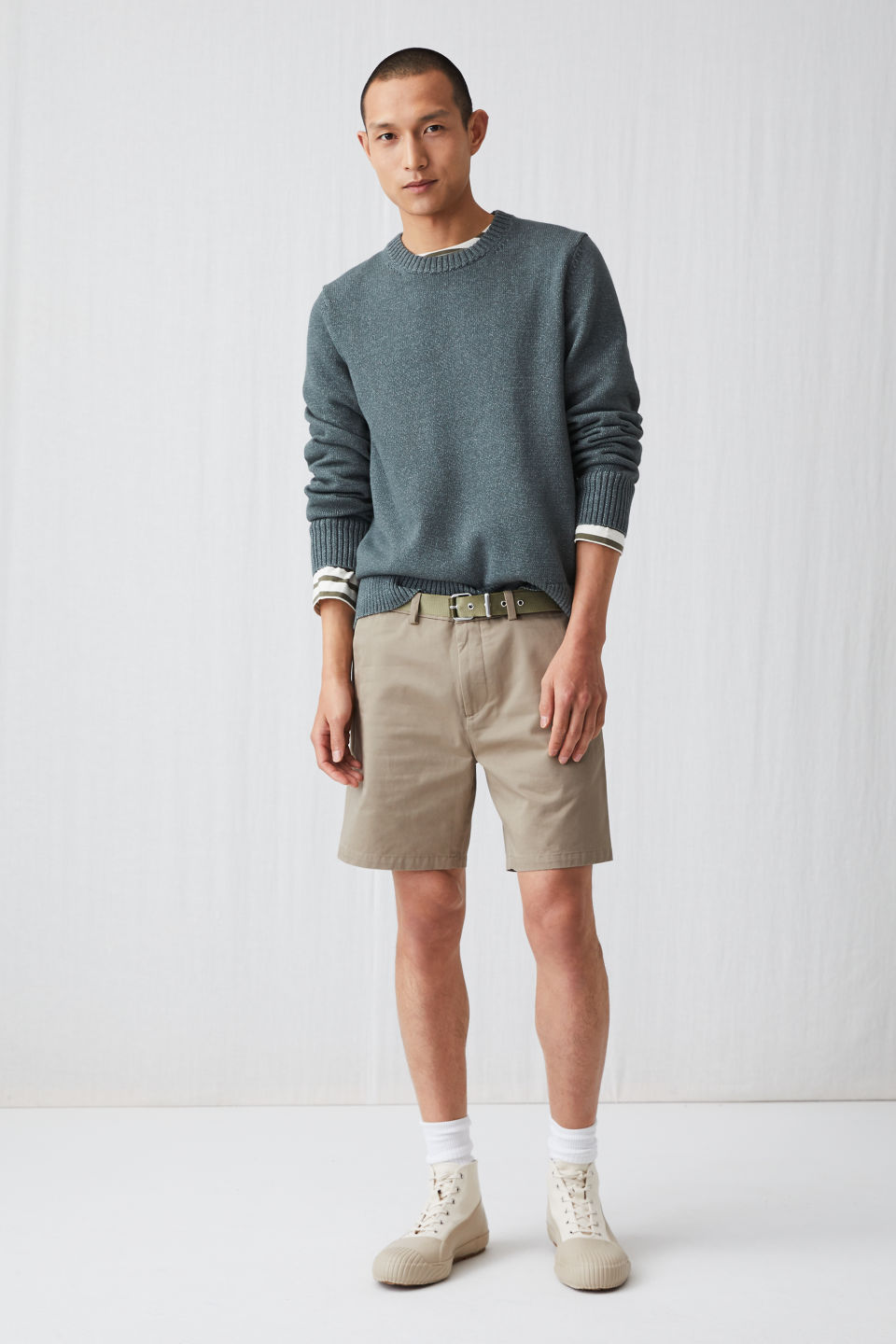 Model side image of Arket standard chino shorts in beige