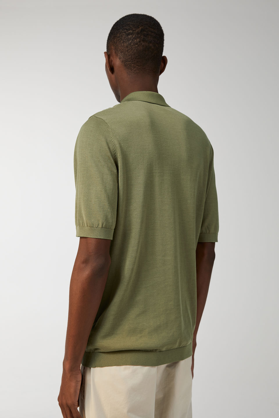 Model side image of Arket fine knit polo shirt in green