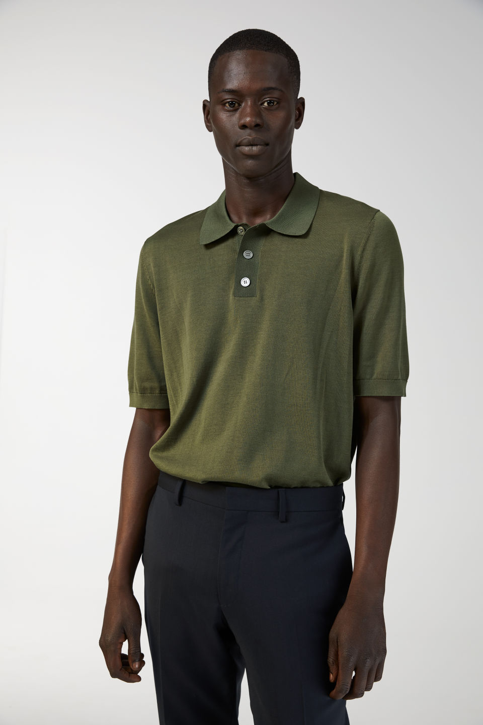 Model side image of Arket cotton silk polo shirt in green