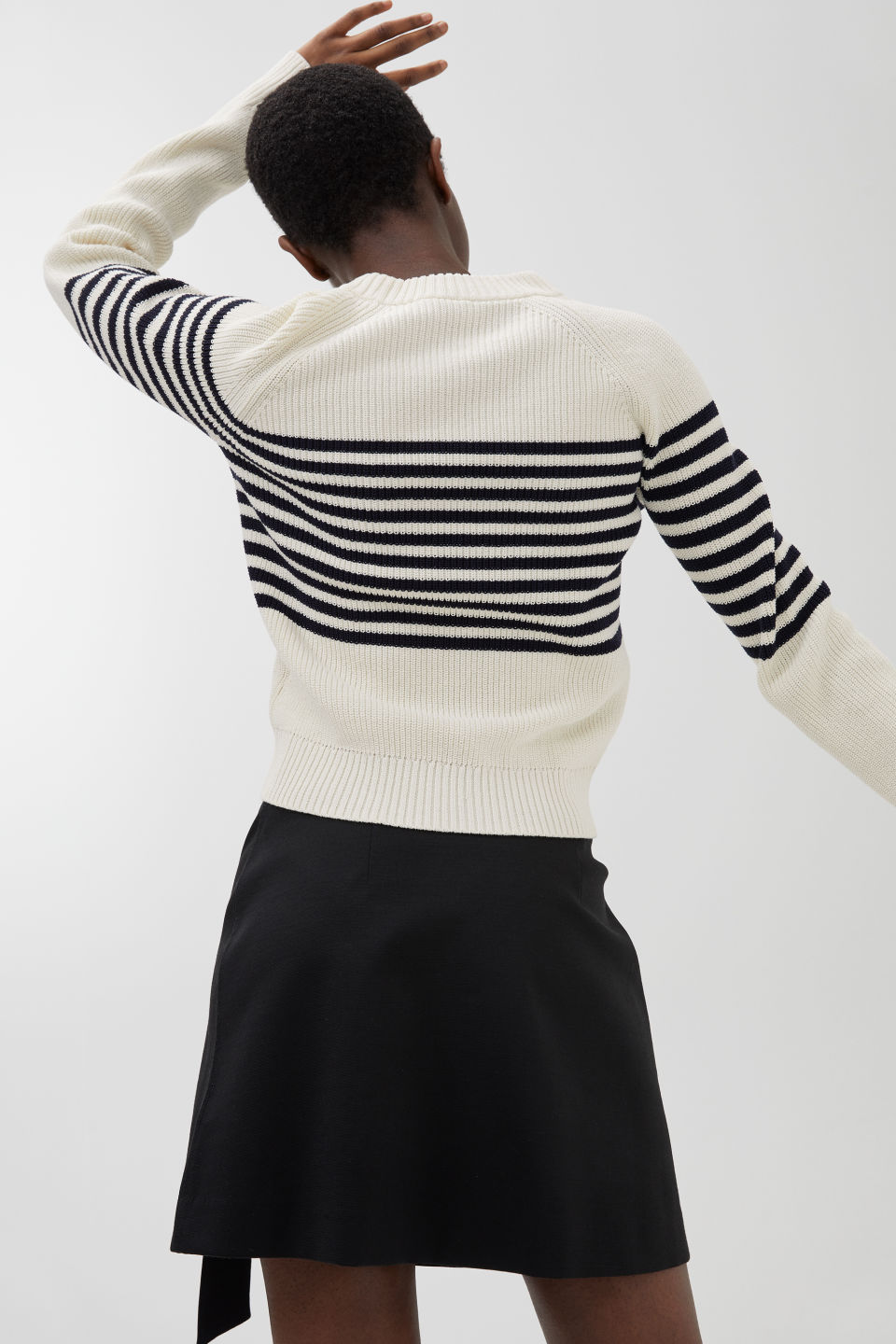 Model side image of Arket dry cotton jumper in blue
