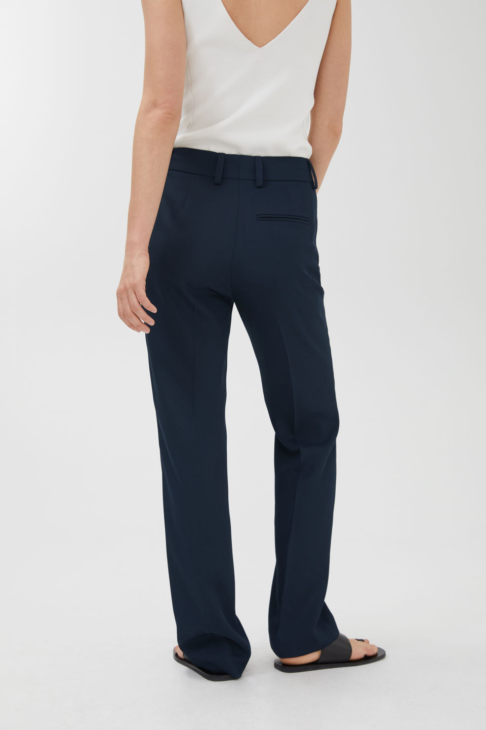 Model side image of Arket no img-fluid twill trousers in blue