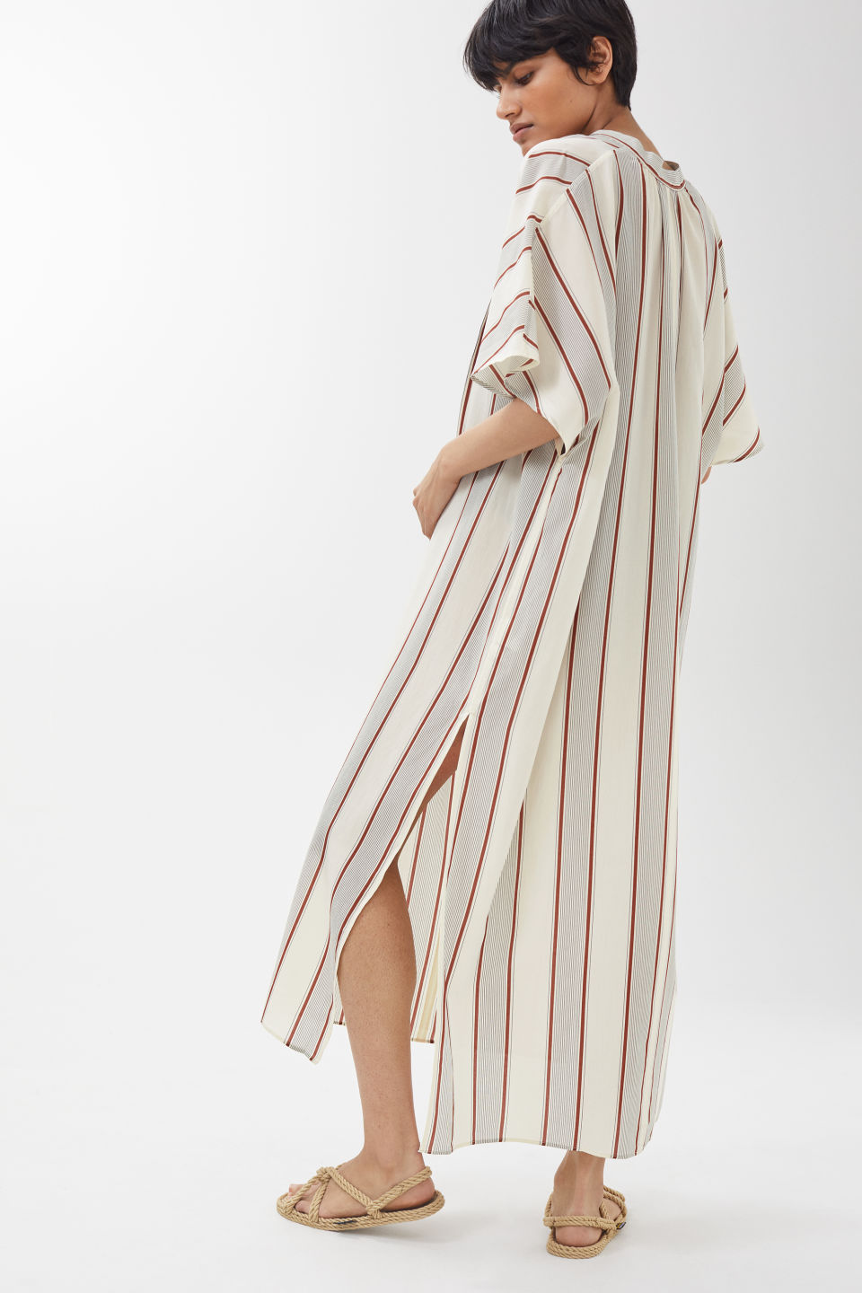 Model side image of Arket no ecom-striped kaftan dress in white