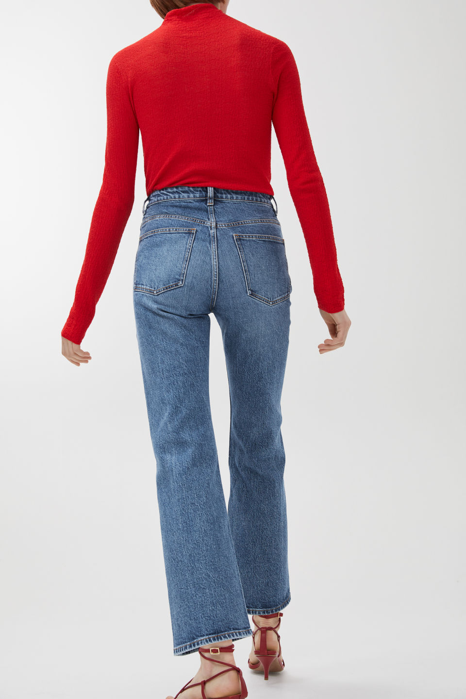 Model side image of Arket cropped denim trousers in blue