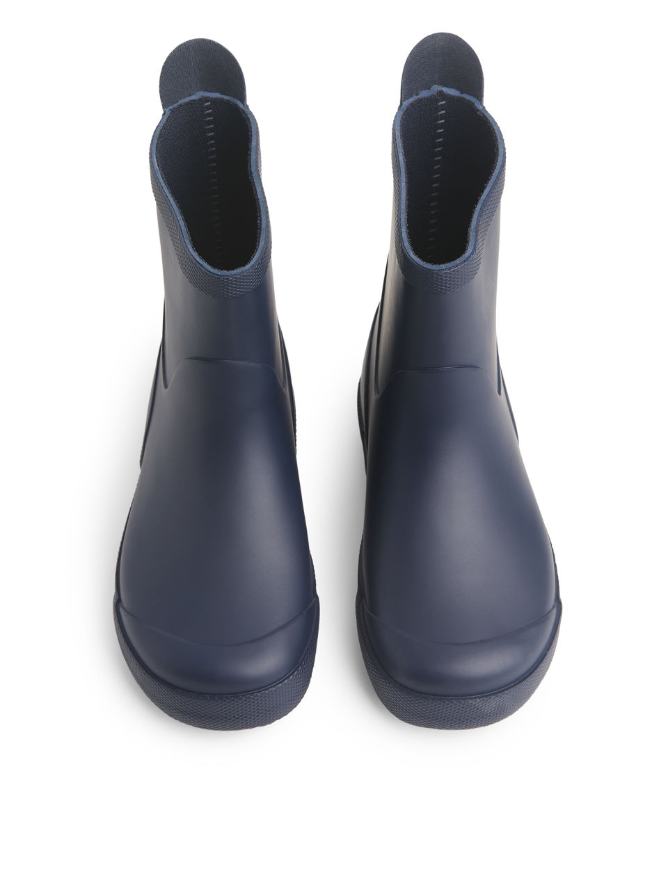 Side image of Arket tretorn wings rubber boots in blue