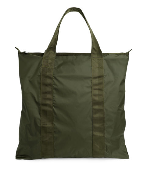 Front image of Arket packable tote in green