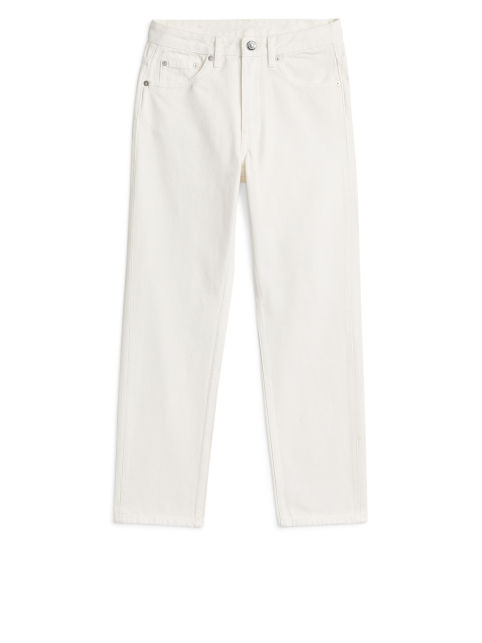 Front image of Arket fitted overdyed jeans in white