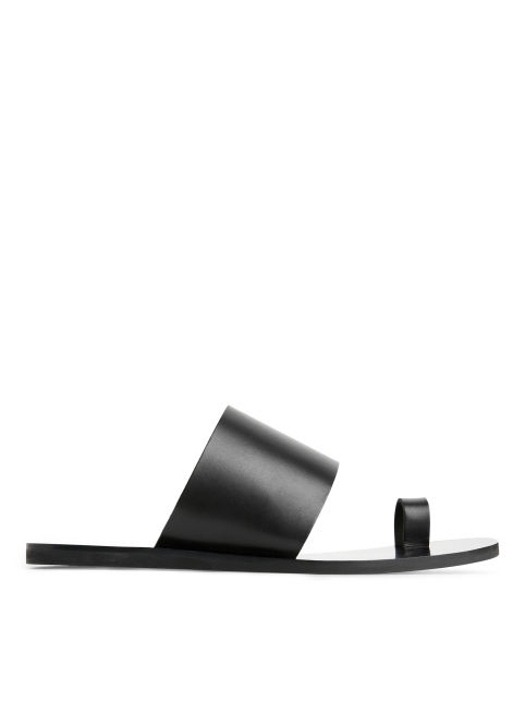 Front image of Arket toe ring sandal in black