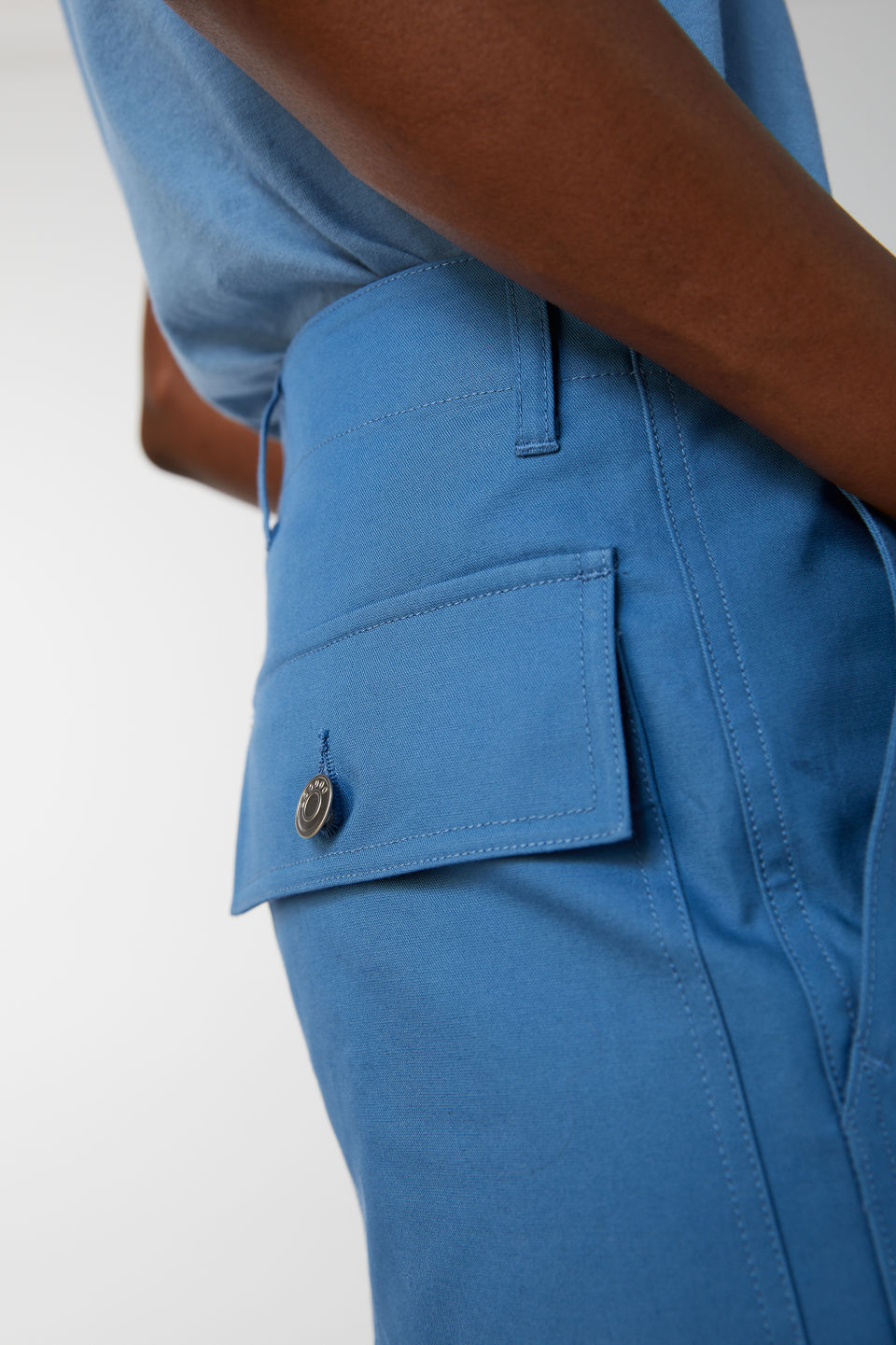 Detailed image of Arket cotton twill workwear trousers in blue