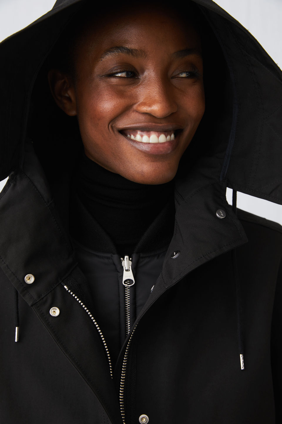 Detailed image of Arket fishtail parka in black