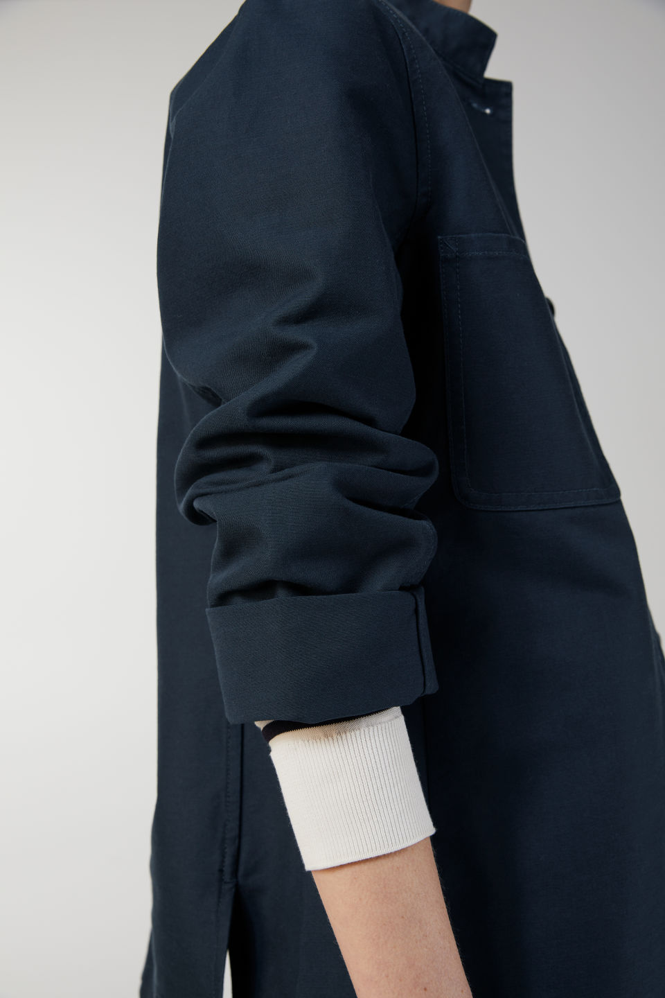 Detailed image of Arket cotton workwear jacket in blue